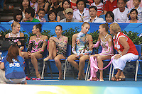 August 23, 2008; Beijing, China; (Third from right) Rhythmic gymnast Inna Zhukova of Belarus speaks to Evgenia Kanaeva of Russia and her coach Vera Shtelbaums . Both gymnasts won medals (silver and gold respectively in the All-Around final at 2008 Beijing Olympics. Others present are (L-R)  Olga Kapranova of Russia, Aliya Yussupova of Kazakhstan, Simona Peycheva of Bulgaria..(©) Copyright 2008 Tom Theobald