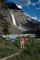 Yoho National Park, Canadian Rockies, BC, British Columbia, Canada - Hiker hiking in Campground at Takakkaw Falls and Yoho River, Summer (Model Released)