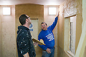 Plastering student working with an instructor, Able Skills, Dartford, Kent.