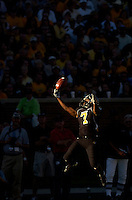 Senior Earl Goldsmith catches a pass in a sliver of light during the third quarter against Texas Tech on homecoming weekend.  The Tigers defeated the Red Raiders 41-10.