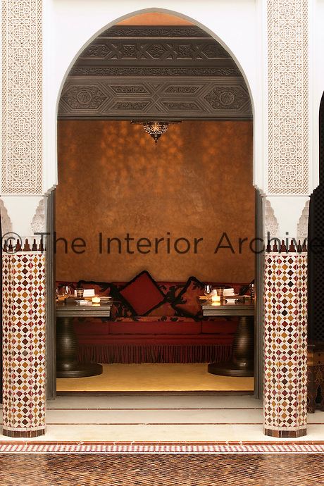 Intimate seating in a warmly decorated alcove at Le Restaurant Marocain