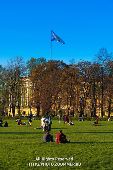 People Sitting On The Lawn In Senate Square Near Admiralty House, St Petersburg
