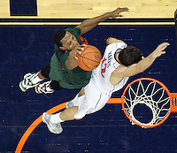 CHARLOTTESVILLE, VA- JANUARY 7: Kenny Kadji #35 of the Miami Hurricanes shoots next to Joe Harris #12 of the Virginia Cavaliers during the game on January 7, 2012 at the John Paul Jones Arena in Charlottesville, Virginia. Virginia defeated Miami 52-51. (Photo by Andrew Shurtleff/Getty Images) *** Local Caption *** Joe Harris;Kenny Kadji