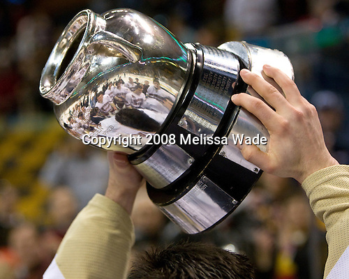 The Eagles are reflected in the Beanpot as a player hoists it high. The Boston College Eagles defeated the Harvard University Crimson 6-5 in overtime on Monday, February 11, 2008, to win the 2008 Beanpot at the TD Banknorth Garden in Boston, Massachusetts.