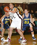 WATERBURY, CT,  02 JANUARY 2006, 010207BZ11- Sacred Heart's Devin Davis (50) looks for a pass under pressure from Kennedy's Marjorie Oliveira (10) and Amber Alberto (23) during their game at Sacred Heart High School in Waterbury Tuesday.<br /> Jamison C. Bazinet Republican-American