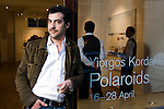 Greek photographer/artist Yiorgos Kordakis photographed outside his exhibition, London - Deslasan