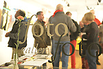 Huntington, New York, U.S. - March 1, 2014 - The Opening Reception '3 Wild & Crazy Artists' at FotoFoto Gallery, seen through front window, presents fine art photography works by Lois Youmans - 'Vitreous Humor – A Collection of Absurd Images,' Barry Feuerstein - 'Red & White Paintings & Photographs – El Vocio Existential,' and Thom O'Connor - 'Hung Out To Dry.'