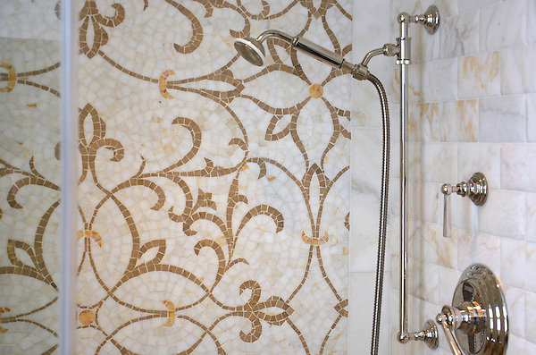 Marabel, a hand cut natural stone mosaic, is shown in Lagos Gold, Crema Valencia, and Cloud Nine.<br />