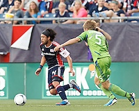 New England Revolution midfielder Lee Nguyen (24) dribbles at midfield. In a Major League Soccer (MLS) match, the New England Revolution tied the Seattle Sounders FC, 2-2, at Gillette Stadium on June 30, 2012.