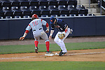 Ole Miss' Preston Overbey (1) drops a grounder as he is bumped by Western Kentucky's Casey Dykes (16) at Oxford-University Stadium in Oxford, Miss. on Wednesday, March 9, 2010.