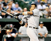 New York Yankees second baseman Robinson Cano (24) strikes out swinging in the first inning against the Baltimore Orioles at Oriole Park at Camden Yards in Baltimore, Maryland in the second game of a doubleheader on Sunday, August 28, 2011.  .Credit: Ron Sachs / CNP.(RESTRICTION: NO New York or New Jersey Newspapers or newspapers within a 75 mile radius of New York City)
