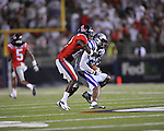 Ole Miss defensive back Cliff Coleman (12) tackles Central Arkansas' Al LAsker (83) at Vaught-Hemingway Stadium in Oxford, Miss. on Saturday, September 1, 2012. (AP Photo/Oxford Eagle, Bruce Newman)..
