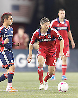 Chicago Fire midfielder Logan Pause (12) brings the ball forward. In a Major League Soccer (MLS) match, the New England Revolution defeated Chicago Fire, 1-0, at Gillette Stadium on October 20, 2012.