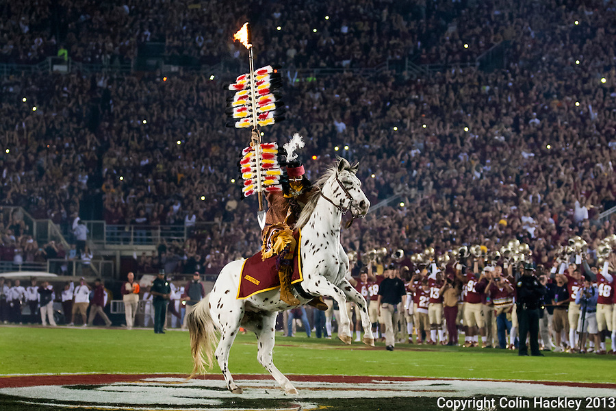 TALLAHASSEE, FL 11/2/13-FSU-MIAMI110213CH-Osceola, portrayed by Florida State University student Drake Anderson, plants the spear at midfield before the Miami game Saturday at Doak Campbell Stadium in Tallahassee. <br /> COLIN HACKLEY PHOTO