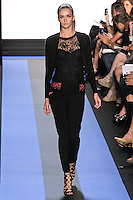 Ella walks runway in a carbon black Chantilly lace v-neck cardigan, carbon black Chantilly lace &frac34; sleeve knit shell, and cyan blue crepe corset with python lace overlay, by Monique Lhuillier, from the Monique Lhuillier Spring 2012 collection fashion show, during Mercedes-Benz Fashion Week Spring 2012.