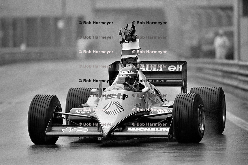 DETROIT, MI - JUNE 5: Eddie Cheever of the United States drives the Renault RE40 02/Renault Gordini with a television camera mounted on the roll hoop during a wet practice session for the Detroit Grand Prix FIA Formula 1 race on the temporary street circuit in Detroit, Michigan, on June 5, 1983.