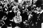 Mrs Margaret Thatcher followed by her son Mark Thatcher ( behind her ) meets the press as she goes to cast her vote in the general election at Chelsea Town Hall London 1979