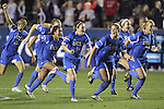 06 December 2013: UCLA players celebrate following the penalty kick shootout. The University of California Los Angeles Bruins advanced over the University of Virginia Cavaliers in penalty kicks following a 1-1 tie at WakeMed Stadium in Cary, North Carolina in a 2013 NCAA Division I Women's College Cup semifinal match.