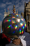 Eccentric woman holds a globe with a Jesus figure on the North Pole during Pope Benedict XVI's papal tour of Britain 2010, the first visit by a pontiff since 1982. Taxpayers footed the £10m bill for non-religious elements, which largely angered a nation still reeling from the financial crisis. Pope Benedict XVI is the head of the biggest Christian denomination in the world, some one billion Roman Catholics, or one in six people. In Britain there are about five million Catholics but only a quarter of Catholics regularly attend Sunday Mass and some churches have closed owing to spending cuts.