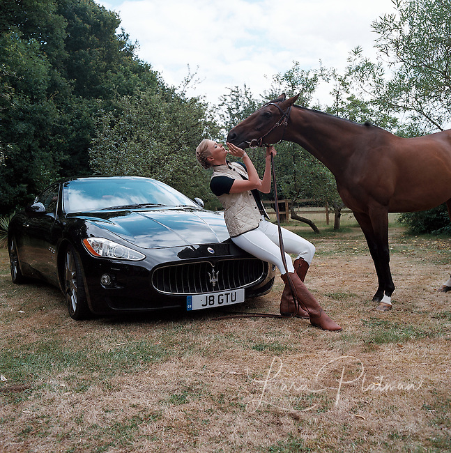 Jodie Kidd with Maserati and Ferrari