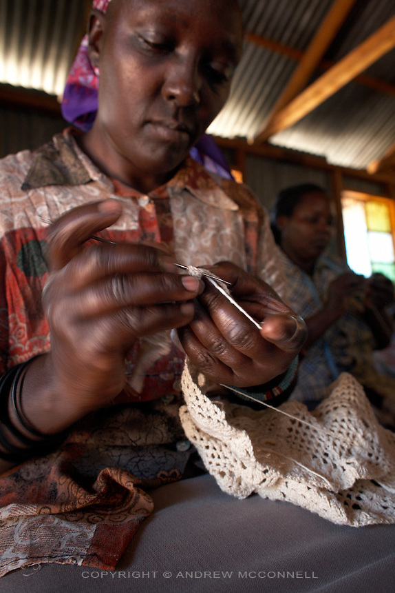"""Irene Wangari, 40, creates a crochet scarf along with her group Totoknits, in the Dagoretti area of Nairobi, Kenya, on Monday, Jan. 12, 2009. The Totoknits group consists of 150 women who produce some of the crochet hand-bags, cases and scarfs for MAX&Co. The products are part of the company's """"ethical fashion"""" range in Africa which is designed to reduce extreme poverty and empower women. The limited edition collection consists of one-of-a-kind handmade accessories such as shoulder-bags, bracelets, key-rings, belts and scarfs."""