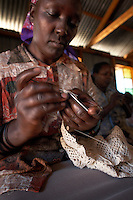 "Irene Wangari, 40, creates a crochet scarf along with her group Totoknits, in the Dagoretti area of Nairobi, Kenya, on Monday, Jan. 12, 2009. The Totoknits group consists of 150 women who produce some of the crochet hand-bags, cases and scarfs for MAX&Co. The products are part of the company's ""ethical fashion"" range in Africa which is designed to reduce extreme poverty and empower women. The limited edition collection consists of one-of-a-kind handmade accessories such as shoulder-bags, bracelets, key-rings, belts and scarfs."