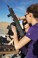"USA. Arizona state. Peoria. Peoria is distant 50 km from Phoenix. Cowtown Shooting Range. Cowtown is a semi-private outdoor shooting range and firearms training facility. Carrie Lightfoot (back) and her colleague Ashley Suris (front) with an AK-47. Both women train their shooting skills with various semi-automatic rifles. Carrie Lightfoot is the founder and CEO of ""The Well Armed Woman. Where the Feminine and Firearms Meet"" which sell online resources for women gun owners. The AK-47 (also known as the Kalashnikov, AK, or Kalash) is a selective-fire automatic or semi-automatic gas-operated 7.62×39mm assault rifle, developed in the Soviet Union by Mikhail Kalashnikov. A firearm is a portable gun, being a barreled weapon that launches one or more projectiles often driven by the action of an explosive force. Most modern firearms have rifled barrels to impart spin to the projectile for improved flight stability. The word firearms usually is used in a sense restricted to small arms (weapons that can be carried by a single person). The right to keep and bear arms is a fundamental right protected in the United States by the Second Amendment of the Bill of Rights in the Constitution of the United States of America and in the state constitutions of Arizona and 43 other states. 28.01.16 © 2016 Didier Ruef"