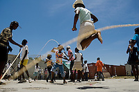 Haitian girls jumping rope in the backyard of Saint Claire, the education and feeding center run by Fr. Gérard Jean-Juste in Port-au-Prince, Haiti, July 8, 2008.