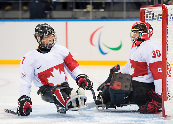 Sochi, RUSSIA - Mar 11 2014 -  Marc Dorion wishes Corbin Watson a good game before Canada takes on Czech Republic in Sledge Hockey at the 2014 Paralympic Winter Games in Sochi, Russia.  (Photo: Matthew Murnaghan/Canadian Paralympic Committee)
