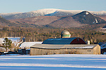 A farm in winter in North Haverhill, New Hampshire.  Mount Moosilauke is in the distance.