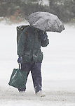 John Adams crosses a street with a load of groceries. A snowstorm hit the Seattle area early morning dumping at least 4 to six inches and will likely continue into the afternoon it a tough commute for drivers  in Seattle on January 18, 2012.  ©2012. Jim Bryant Photo. All Rights Reserved.