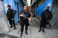 Beggining of operations of the UPP - Pacifying Police Unit inside Favela do Caju in the harbor area of Rio de Janeiro, Brazil. Unidade de Polícia Pacificadora, also translated as Police Pacification Unit, abbreviated UPP, a law enforcement and social services program which aims at reclaiming territories, more commonly favelas, controlled by gangs of drug dealers. Batalhão de Operações Policiais Especiais (BOPE), Special Police Operations Battalion is a special forces unit of the Military Police of Rio de Janeiro State, Brazil. Due to the nature of crime in favelas, BOPE units have extensive experience in urban warfare as well as progression in confined and restricted environments. It also utilizes equipment deemed more powerful than traditional civilian law enforcement.