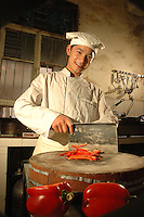 A young Nepali chef named Prabin at the Naga Restaurant in Lhasa, Tibet. It is located at the crossing of Zang Yi Lu about four minutes far away from Jokhang Temple..