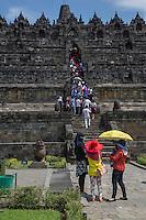 Borobudur, Java, Indonesia.  Tourists Ascending the Temple Steps, Eastern Face.