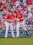19 September 2015: Washington Nationals first baseman Tyler Moore is greeted at third by third base coach Bob Henley after hitting a solo home run in the 5th inning against the Miami Marlins at Nationals Park in Washington, DC. The Nationals defeated the Marlins 5-2 in the third game of their 4-game series. Mandatory Credit: Ed Wolfstein Photo *** RAW (NEF) Image File Available ***