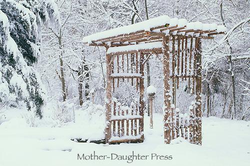 Garden arbor with snow