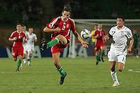 Hungary's Janos Szabo (2)  takes charge of the ball against Italy's Mattia Mustacchio (17) during the FIFA Under 20 World Cup Quarter-final match at the Mubarak Stadium  in Suez, Egypt, on October 09, 2009. Hungary won 2-3 in overtime.