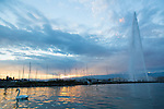 The Jet d'Eau is a large fountain in Geneva, Switzerland, and is one of the city's most famous landmarks. It is also one of the largest fountains in the world. Situated at the point where Lake Geneva empties into the Rhône, it is visible throughout the city and from the air.  Five hundred litres (132 gallons) of water per second are jetted to an altitude of 140 metres (459 feet).  The water leaves the nozzle at a speed of 200 km/h (124 mph). When it is in operation, at any given moment there are about 7,000 litres (1849 gallons) of water in the air. Unsuspecting visitors to the fountain—which can be reached via a stone jetty from the left bank of the lake—may be surprised to find themselves drenched after a slight change in wind direction.Geneva, Switzerland, Europe