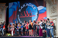 "Moscow, Russia, 25/09/2010..Contestants perform ""We Are The World"" at the end of the Karaoke World Championships 2010, where amateur singers from around the world competed for prizes that included one million Russian dumplings."