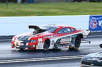 May 30, 2014; Englishtown, NJ, USA; NHRA pro mod driver Mike Janis during qualifying for the Summernationals at Raceway Park. Mandatory Credit: Mark J. Rebilas-