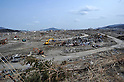 April 2nd, 2011, Rikuzentakata, Japan - Heavy machines clear off debris, making roads and open spaces in Rikuzentakata City, Iwate Prefecture, on April 2, 2011, three weeks after this Japanese coastal city was wiped out by a tsunami that followed a magnitude 9.0 earthquake. Rikuzentakata was one of the worst-hit town in the entire northeastern region. (Natsuki Sakai/AFLO) [3615] -mis-...