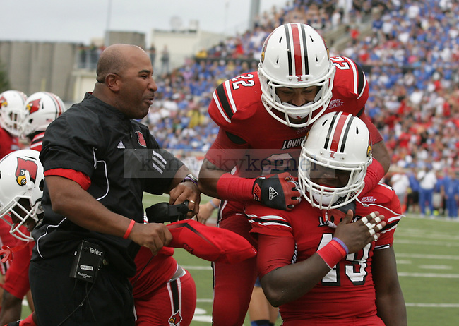 Deon Rogers and a University of Louisville teammate celebrate during the game against the University of Kentucky on Sunday, Sept. 2, 2012 in Papa John's Stadium in Louisville, Ky. Louisville won 32-14. Photo by Latara Appleby | Staff .