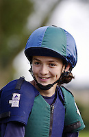 Young woman takes part in an eventing competition, United Kingdom