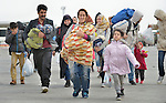 Refugees walk across the border into Austria near the Hungarian town of Hegyeshalom. Hundreds of thousands of refugees and migrants--including many children and families--flowed through Hungary in 2015, on their way to western Europe from Syria, Iraq and other countries.