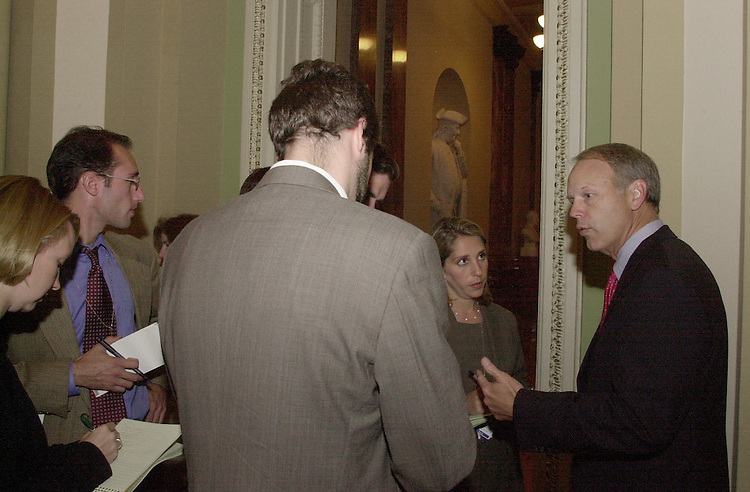 NicklesD.1(DG)092800 -- Don Nickles, R-Okla., is ganged up on by bans of roving reporters as the Senate tried to finish up business before going home to campaign.