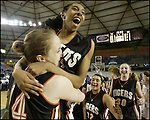 Lewis & Clark Tigers' Heather Bowman ,left, hoists teammate Brittany Kennedy after beating the  Prairie Falcons' 66-44 in their 4A WIAA Championship  basketball game Saturday, March 10, 2006, in Tacoma. (Jim Bryant Photo)