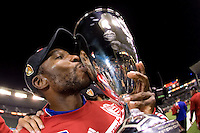 FC Dallas midfielder Marvin Chavez hoists the Western Conference Championship trophy. FC Dallas defeated the LA Galaxy 3-0 to win the Western Division 2010 MLS Championship at Home Depot Center stadium in Carson, California on Sunday November 14, 2010.