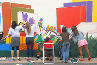 Teachers, parents, and students help paint Artist David Legaspi's enviromental -themed mural at Franklin Elementary School on Sunday, October 23, 2011