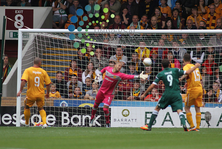 Lazaros Christodoulopoulos's shot evades Motherwell keeper Darren Randolph to make it 1-0 to the greeks. Motherwell take on Greek side Panathinaikos in the UEFA Champions League Third Qualifying Round at Fir Park Motherwell on the 31st July 2012. Universal News And Sport (Europe) All pictures must be credited to www.unpixs.com. (Office)0844 884 51 22.