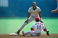 ST. LOUIS, MO - Barry Bonds of the Pittsburgh Pirates is called out at second base as St. Louis Cardinals infielder Jose Oquendo makes the play during a game at Busch Stadium in St. Louis, Missouri on September 30, 1990. Photo by Brad Mangin